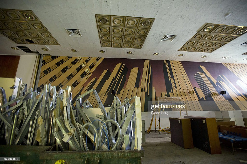 Debris from demolition work sits in front of a decorative mural in the lobby of 75 Rockefeller Plaza in New York, U.S., on Monday, Aug. 18, 2014. New landlord RXR Realty Corp. is upgrading the entire 630,000 square feet. The $150 million project includes raising office ceilings from 7.5 feet (2.3 meters) to 9 feet, and relocating mechanical equipment from the top floor to create new high-priced space, said Scott Rechler, RXRís chief executive officer. Photographer: Jin Lee/Bloomberg via Getty Images
