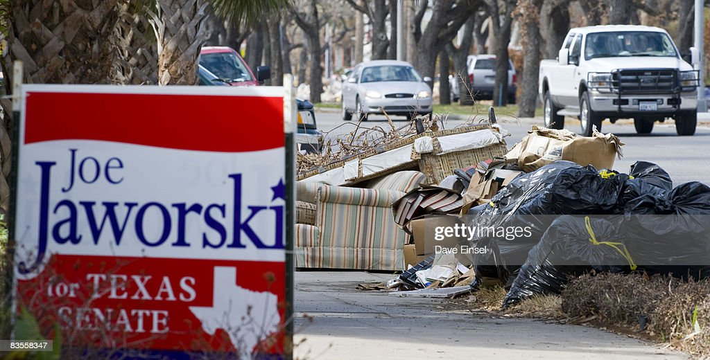 Debris from Hurricane Ike still lines Broadway Boulevard November 4, 2008 in Galveston, Texas. Voter turnout has been light as residents are still in the process of rebuilding after Ike. After nearly two years of presidential campaigning, U.S. citizens go to the polls today to vote in the election between Democratic presidential nominee U.S. Sen. Barack Obama (D-IL) and Republican nominee U.S. Sen. John McCain (R-AZ).