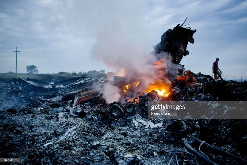 Debris from Malaysia Airlines Flight 17 is shown smouldering in a field July 17 2014 in Grabovo Ukraine near the Russian border Flight 17 on its way...