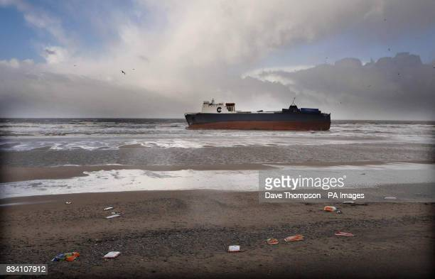 Debris from the cargo ship Riverdance which has run aground at Blackpool due to the high winds lies on the beach