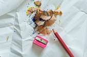 Crayons and debris from the sharpening on white background