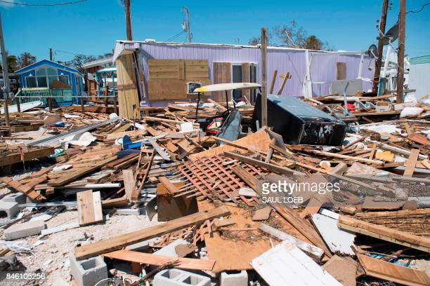 Debris from trailer homes destroyed by Hurricane Irma litters the Seabreeze Trailer Park in Islamorada in the Florida Keys September 12 2017 / AFP...