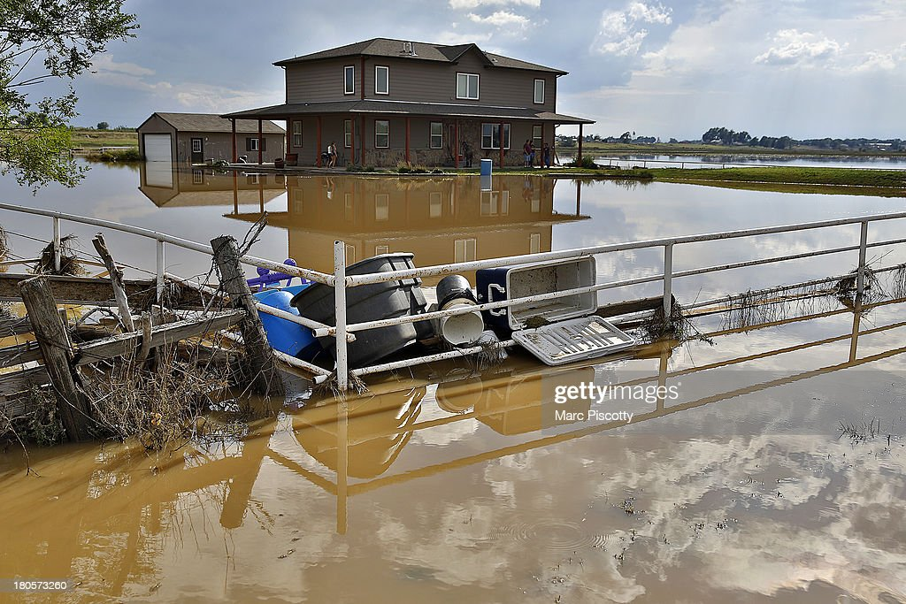 Debris gathers in the corner of a fence in front of a home on September 14, 2013 in La Salle, Colorado. Heavy rains for the better part of week fueled widespread flooding in numerous Colorado towns. The historic flooding forced thousands to evacuate the area and more rain is predicted through the weekend.