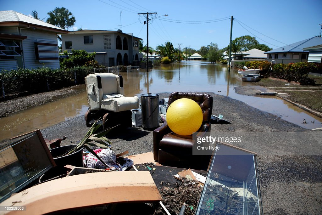 Debris in the street as parts of southern Queensland experiences record flooding in the wake of Tropical Cyclone Oswald on January 30, 2013 in Bundaberg, Australia. Flood waters peaked at 9.53 metres in Bundaberg yesterday and began receding overnight, as residents and relief teams prepare to clean-up debris. Four deaths have been confirmed in the Queensland floods and the search is on for two men though to be missing in floodaters in Gatton.