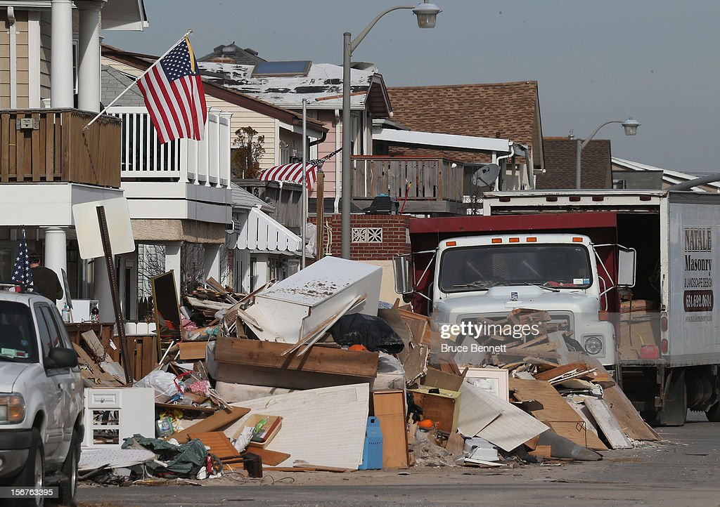 Debris is left out for removal on November 20, 2012 in Long Beach, New York. More than three weeks after Superstorm Sandy hit the New York area, residents continue their restoration efforts in many affected areas on Long Island.