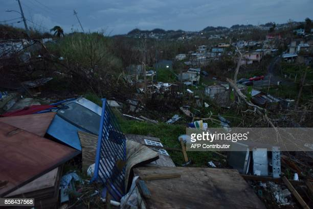 Debris is scattered around a destroyed house in the Acerolas neighbourhood in Toa Alta Puerto Rico on October 1 2017 President Donald Trump...