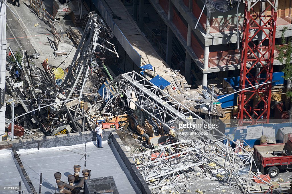 debris is scattered on the ground at the scene of a crane collapse on upper