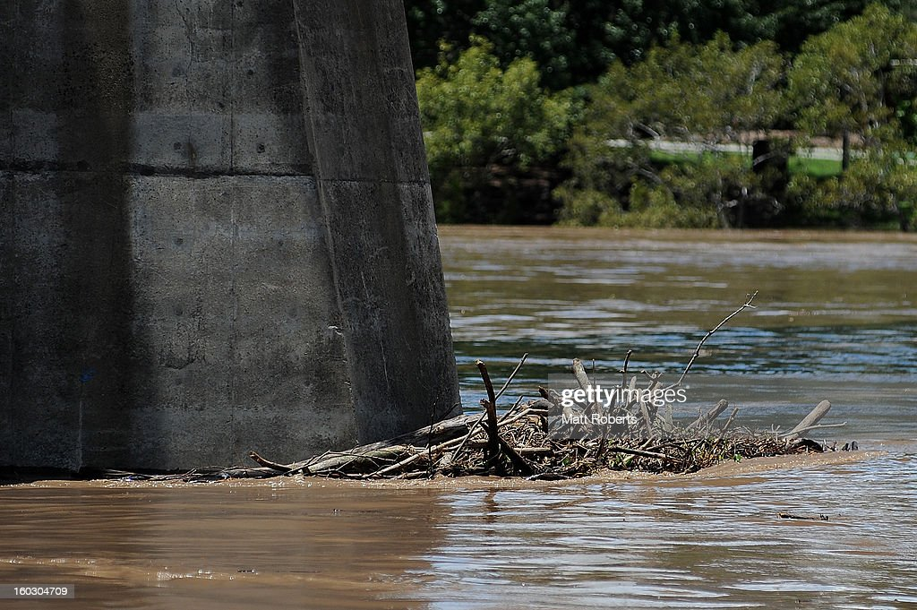 Debris is seen caught on a bridge in the Brisbane river as parts of southern Queensland experiences record flooding in the wake of Tropical Cyclone Oswald on January 29, 2013 in Brisbane, Australia. The river in the Brisbane CBD is expected to peak at 2.3 metres today - lower than the 2.6 metre peak predicted - but is still likely to flood low-lying properties and businesses. The flood crisis has claimed four lives so far, with the city of Bundaberg, Queensland faces the worst flooding in it's history.