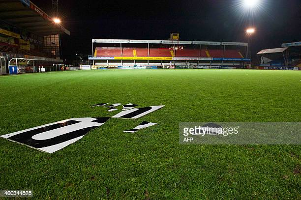 Debris is seen on the field after a storm caused damage to the stadium of Belgian football team KV Mechelen in Mechelen on January 3 2014 High tides...