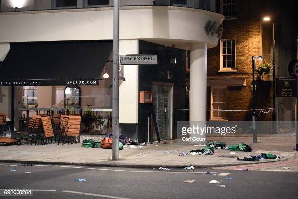 Debris is strewn outside a cafe near London Bridge on June 4 2017 in London England Police responded to what they are calling terrorist attacks on...