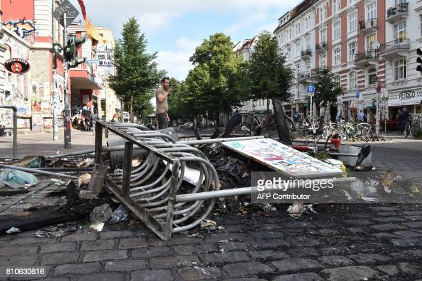Debris lay in the street after riots in Hamburg's Schanzenviertel district on July 8 2017 in Hamburg northern Germany where leaders of the world's...
