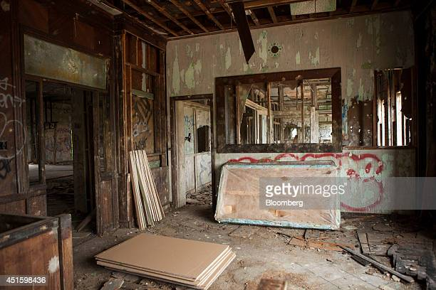 Debris lays in the empty rooms of an abandoned factory on Federal Street in Camden New Jersey US on Monday June 23 2014 Artist Chris Toepfer founder...