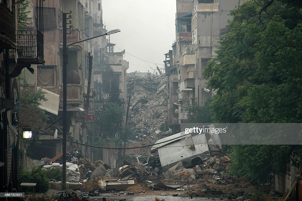 Debris lie on a deserted street in the old city of Homs on May 8 2014 after Syrian government forces regained control of rebelcontrolled areas A last...