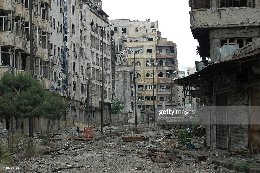 Debris lie on a street in the Christian neighborhood of Hamidieh in the old city of Homs on May 8 2014 after Syrian government forces regained...
