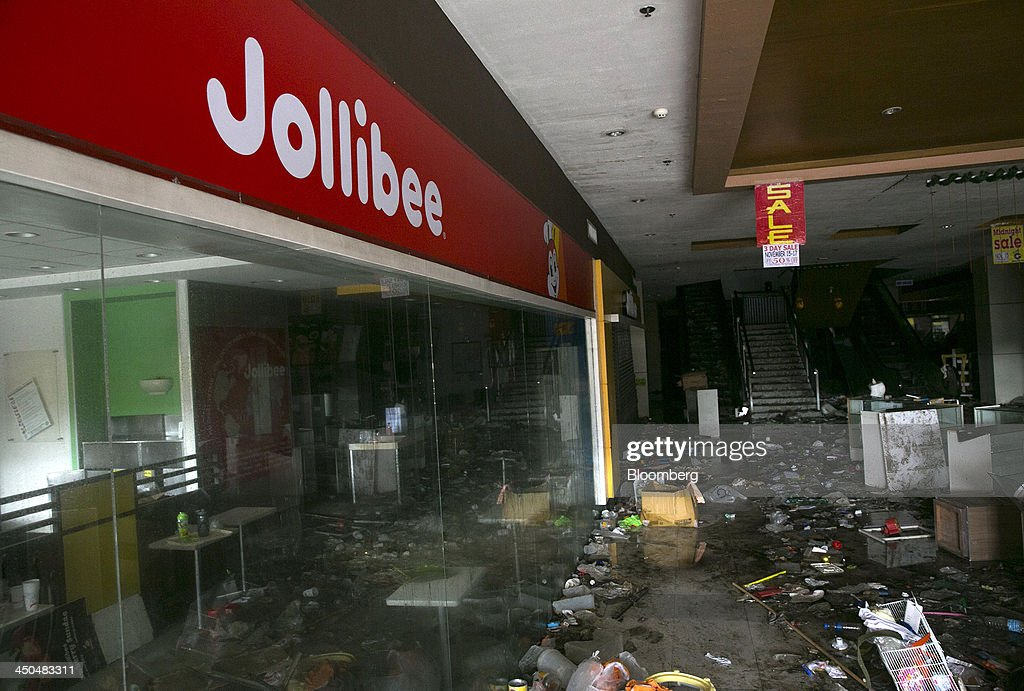 Debris lies outside a Jollibee Foods Corp. fast-food restaurant inside the Gaisano Central shopping mall, operated by Gaisano Capital Group, in Tacloban, the Philippines, on Monday, Nov. 18, 2013. Super Typhoon Haiyan slammed into the central Philippines on Nov. 8, knocking down most buildings, killing thousands, displacing 4 million people and affecting more than 10 million. Photographer: Paula Bronstein/Bloomberg via Getty Images