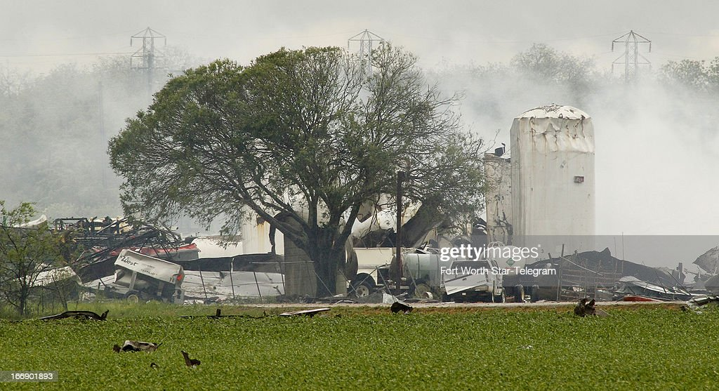 Debris litters fields around a fertilizer plant in West, Texas, on Thursday, April 18, 2013. Much of the small town suffered damage when the plant caught fire causing a massive explosion Wednesday night. Authorities are still trying to determine the death and injury toll.