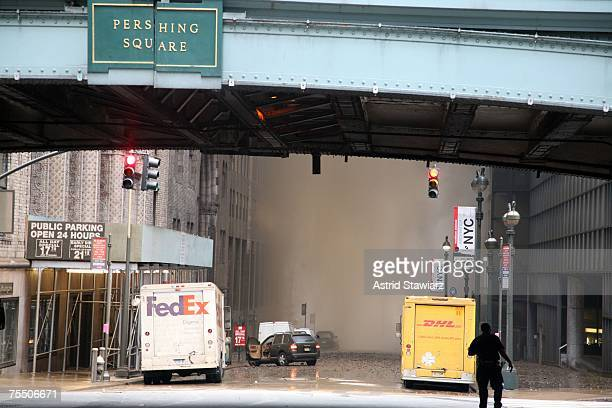 Debris litters the street around Pershing Square after a steam pipe explosion that occurred during rush hour in midtown Manhattan July 18 2007 in New...