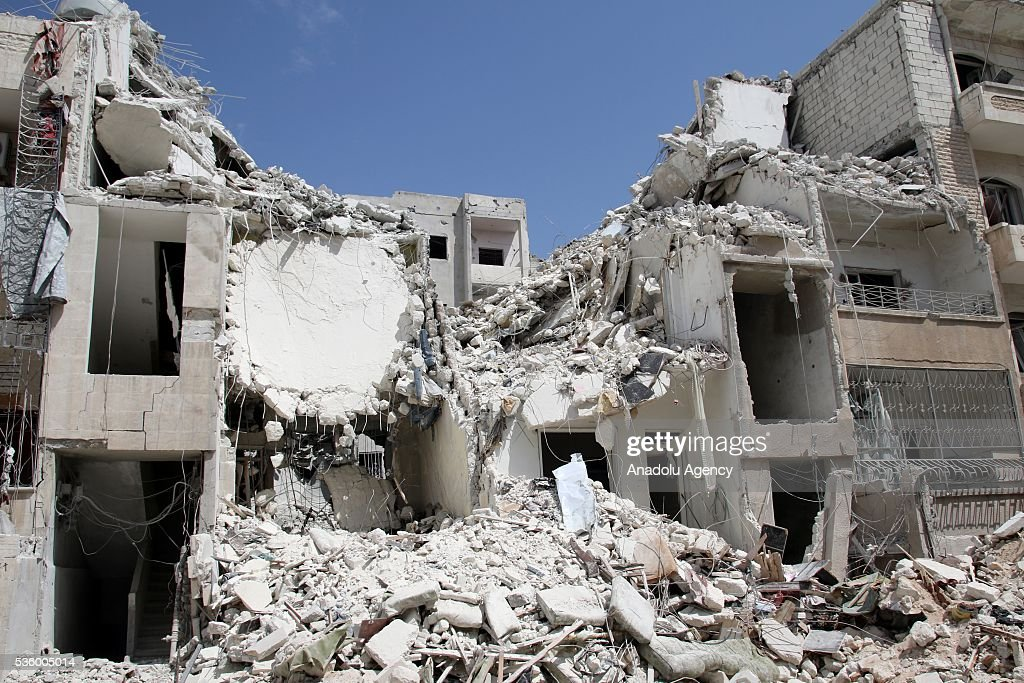 A debris of a building is seen after the Russian airstrikes targeted Sevra district of Idlib in Syria on May 31, 2016.