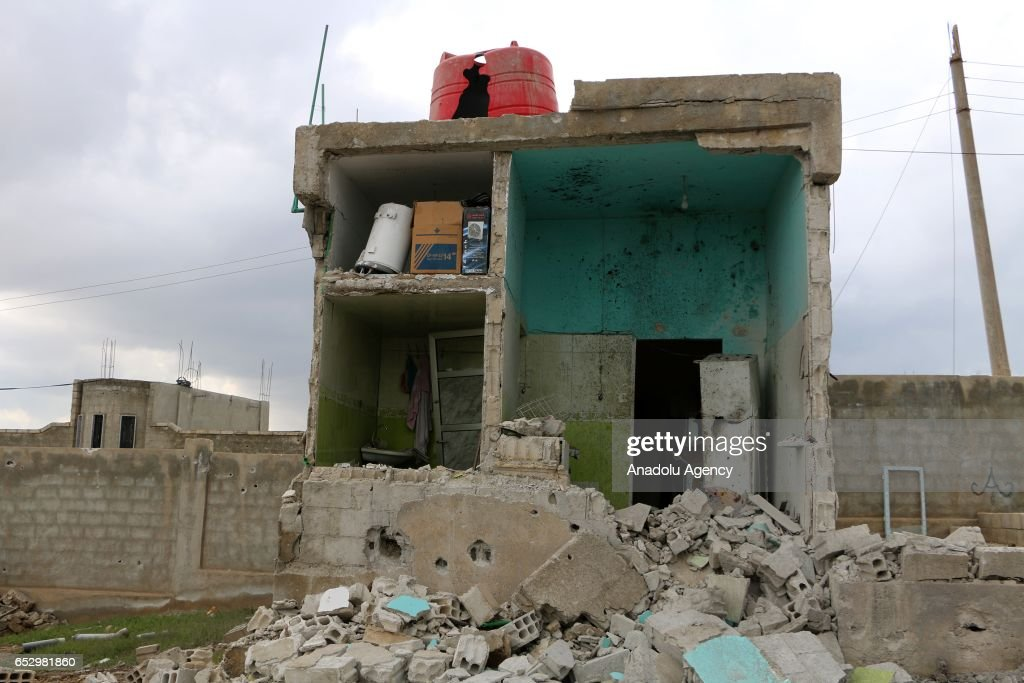 Debris of a building is seen after warcrafts belonging to Assad Regime forces carried out airstrike in Umm al-Mayadeen district of Daraa, Syria on March 13, 2017.