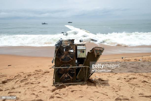 Debris of a cargo plane that crashed off Ivory Coast are pictured on the beach of PortBouet in Abidjan on October 14 2017 An Antonov cargo plane that...