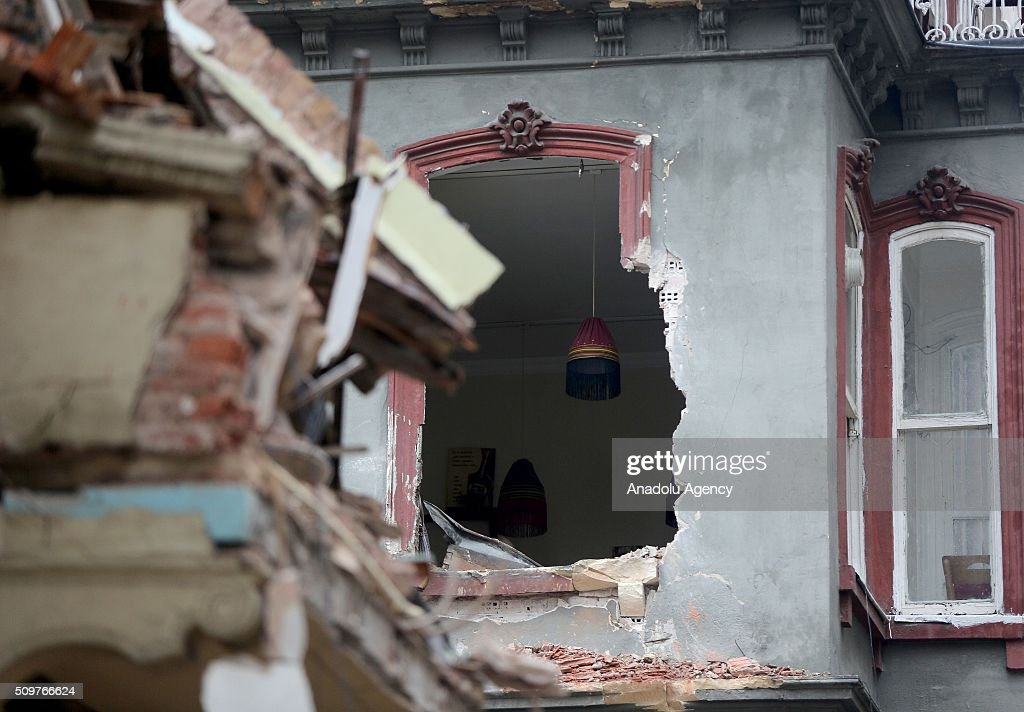 Debris of a collapsed buildings are seen at Zambak street of Tarlabasi neighborhood in Istanbul, Turkey on February 12, 2016.