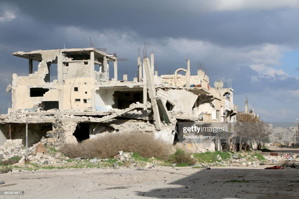 Debris of buildings are seen after warcrafts belonging to Assad Regime forces carried out airstrike in Daraa, Syria on March 13, 2017.