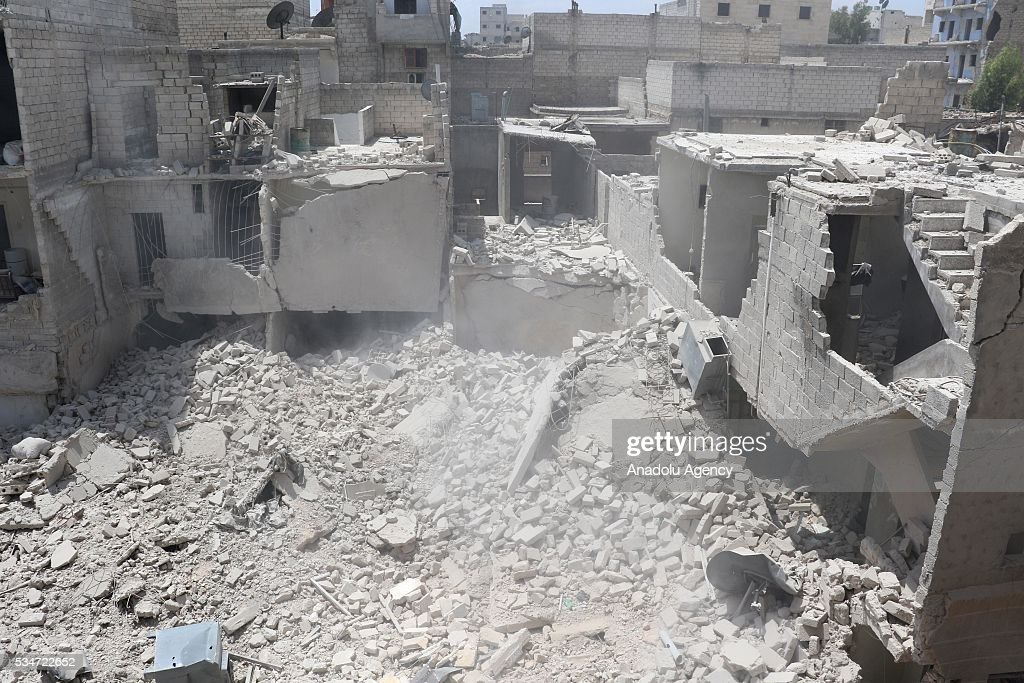 Debris of collapsed buildings are seen after Asad Regime's air-strike over residential areas at al-Maysir neighborhood of Aleppo, Syria on May 27, 2016.