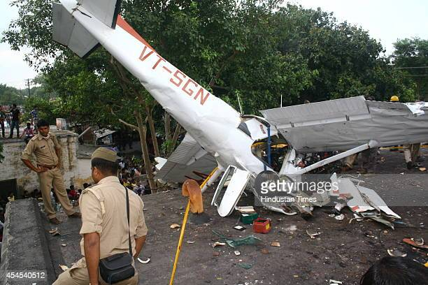 Debris of glider plane flown by a woman trainee pilot after it crashed into roof of house on September 3 2014 in Kanpur India The pilot was admitted...