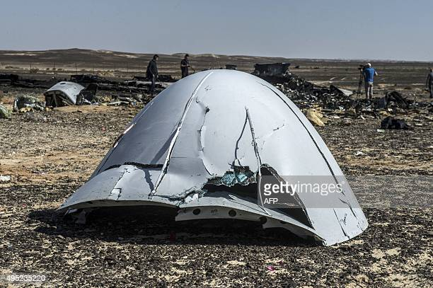 Debris of the A321 Russian airliner lie on the ground a day after the plane crashed in Wadi alZolomat a mountainous area in Egypt's Sinai Peninsula...