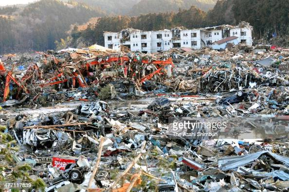 Debris scattered Minamisanriku City is seen a day after a 90 magnitude strong earthquake and subsequent tsunami struck on March 12 2011 in...