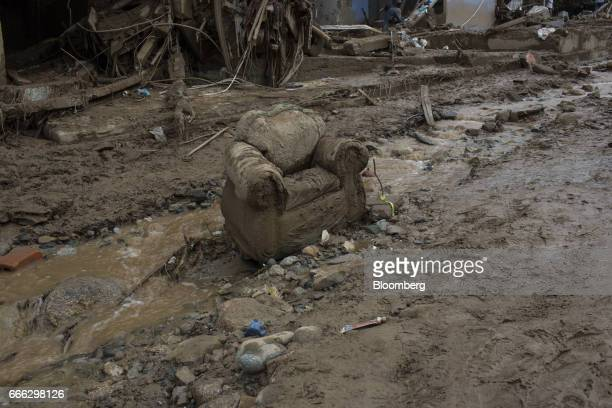 Debris sits in the middle of a street as mud and water continue to flow after a landslide in the Paolo VI neighborhood of Mocoa Putumayo Colombia on...