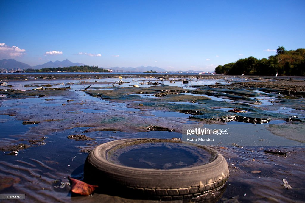 Debris sits near the shoreline of the polluted waters of Guanabara Bay between the cities of Rio de Janeiro and Niteroi on July 30, 2014 in Rio de Janeiro, Brazil. The iconic bay will be the site of sailing events during the Rio 2016 Olympic Games. Although Rio's Olympic bid included the promise to clean up the filthy bay, industrial and human pollution still remain a major problem. According to the Deputy State Secretary of Environment just 34% of Rio's sewage is treated while the remainder flows untreated into the waters.