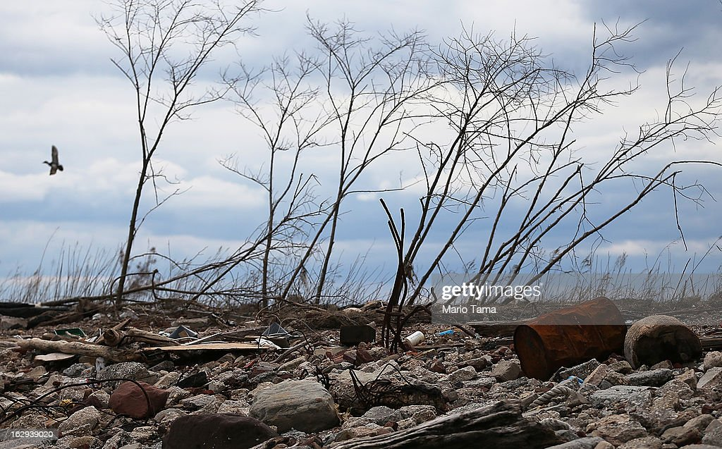 Debris sits on a still-closed beach area damaged by flooding from Hurricane Sandy on March 1, 2013 in the Staten Island borough of New York City. A government plan to purchase properties in Staten Island damaged by the storm remains on track.