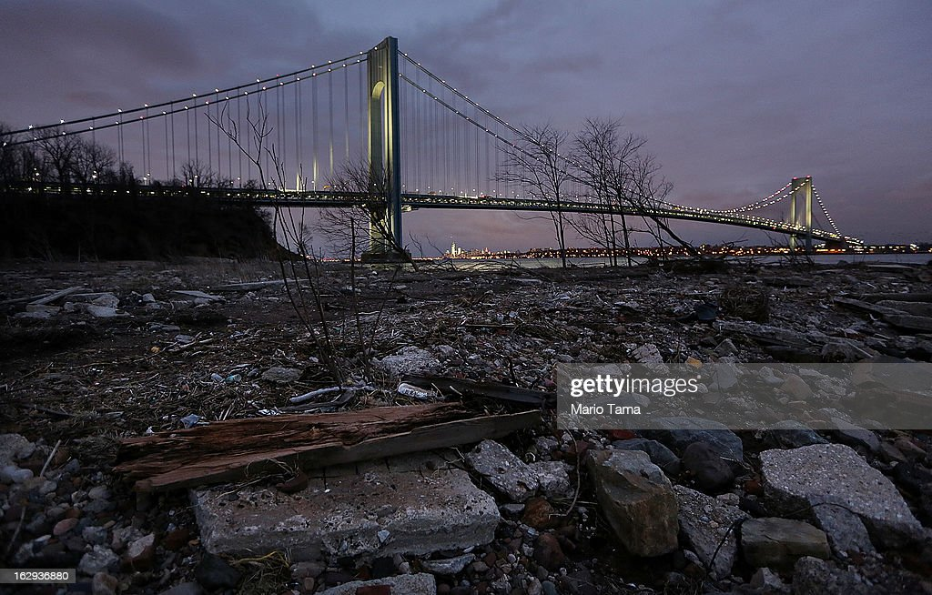 Debris sits on a still-closed beach area damaged by flooding from Hurricane Sandy near the Verrazano-Narrows Bridge on March 1, 2013 in the Staten Island borough of New York City. A government plan to purchase properties in Staten Island damaged by the storm remains on track.