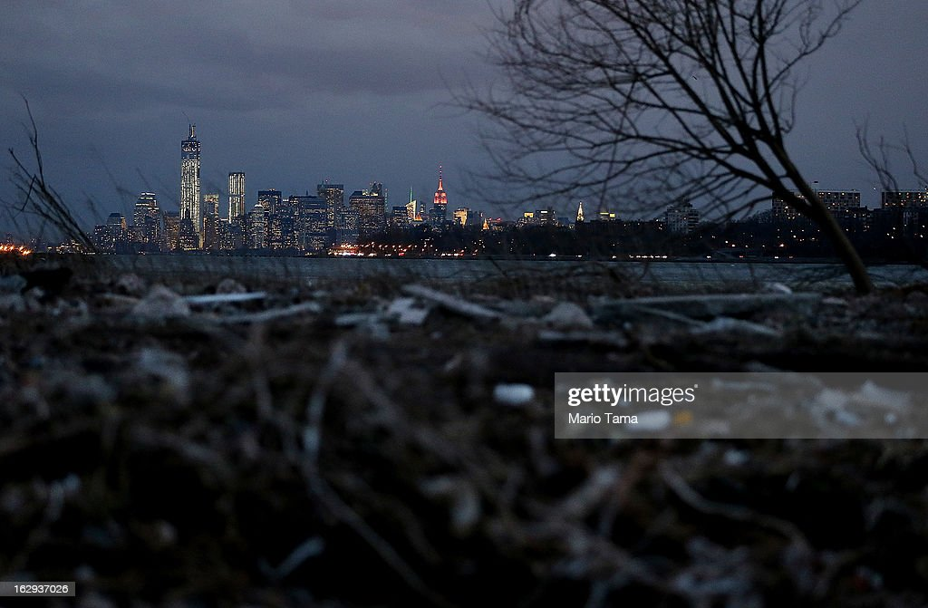 Debris sits on a still-closed beach area damaged by flooding from Hurricane Sandy with Lower Manhattan at back left on March 1, 2013 in the Staten Island borough of New York City. A government plan to purchase properties in Staten Island damaged by the storm remains on track.