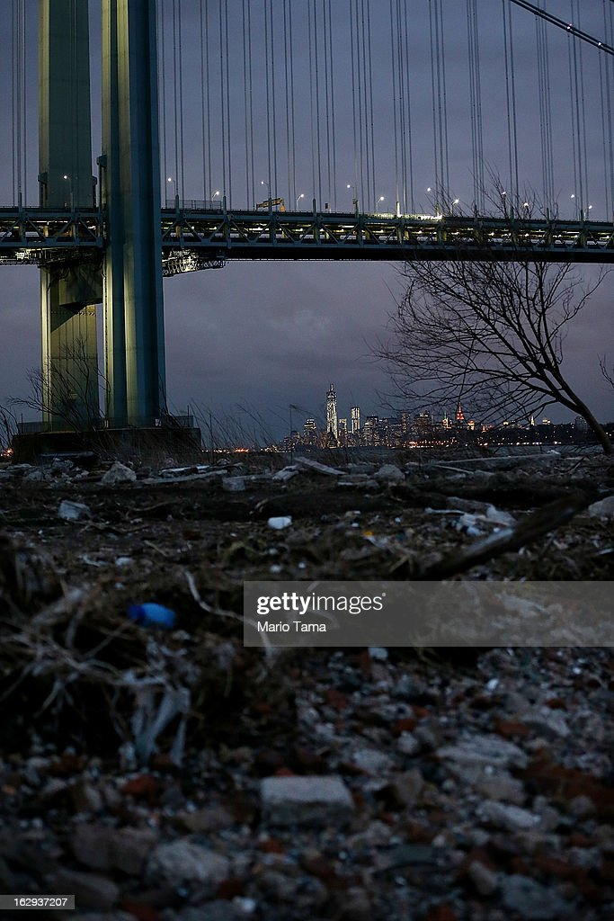Debris sits on a still-closed beach area damaged by flooding from Hurricane Sandy with Lower Manhattan back center on March 1, 2013 in the Staten Island borough of New York City. A government plan to purchase properties in Staten Island damaged by the storm remains on track.