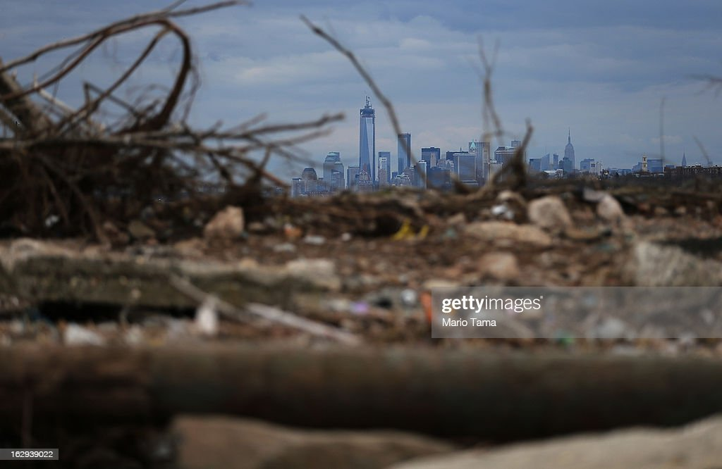 Debris sits on a still-closed beach area damaged by flooding from Hurricane Sandy with Lower Manhattan and One World Trade Center in the background on March 1, 2013 in the Staten Island borough of New York City. A government plan to purchase properties in Staten Island damaged by the storm remains on track.