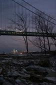 Debris sits on a stillclosed beach area damaged by flooding from Hurricane Sandy near the VerrazanoNarrows Bridge in Staten Island with Lower...