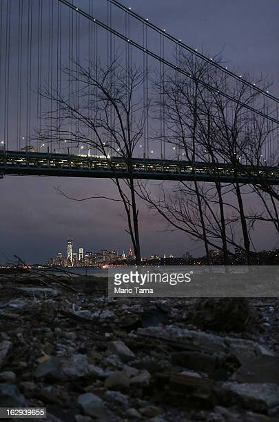 Debris sits on a stillclosed beach area damaged by flooding from Hurricane Sandy near the VerrazanoNarrows Bridge in Staten Island with Lower...