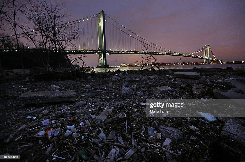 Debris sits on a still-closed beach area damaged by flooding from Hurricane Sandy near the Verrazano-Narrows Bridge properties in Staten Island damaged by the storm remains on track.