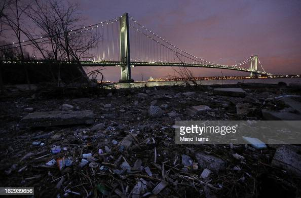 Debris sits on a stillclosed beach area damaged by flooding from Hurricane Sandy near the VerrazanoNarrows Bridge properties in Staten Island damaged...