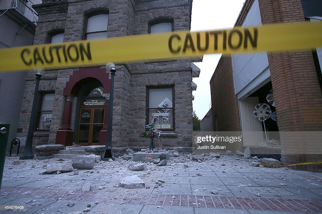 Debris sits on the ground in front of a damaged building following a reported 6.0 earthquake on August 24, 2014 in Napa, California. A 6.0 earthquake rocked the San Francisco Bay Area shortly after 3:00 am on Sunday morning causing damage to buildings and sending at least 70 people to a hospital with non-life threatening injuries.
