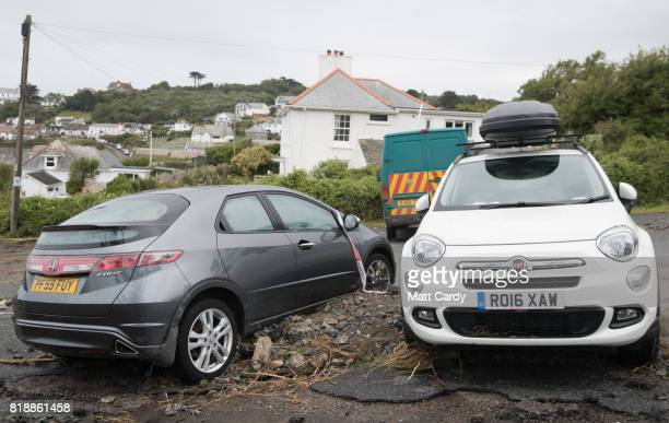 Debris surrounds cars parked in the village of Coverack following flash flooding on July 19 2017 in Coverack England A major incident was declared...