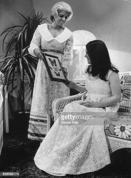 Debs' MadeInDenver Gowns to Preview Saturday Mrs Leigh Norgren and daughter Karen who models a reembroidered white silk organza by designer Ursula...