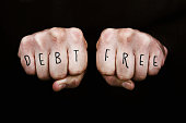 Debt Free written across the knuckles of two clenched fists.  Note that the font design is my own.