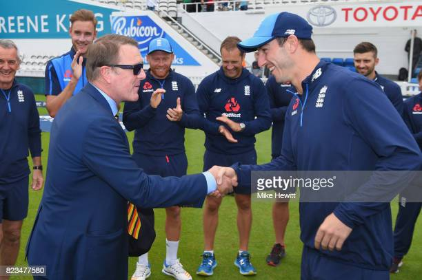 Debutant Toby RolandJones of England receives his cap from Phil Tufnell ahead of Day One of the 3rd Investec Test between England and South Africa at...