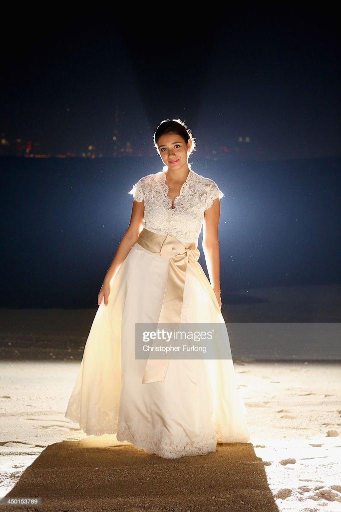Debutante Anna Zaphiriou-Zarifi, aged 17, poses on the beach of Royal Island during The London Season Ball on The World on November 14, 2013 in Dubai, United Arab Emirates. Debutantes, royalty and aristocracy, attended The London Season Ball on the World hosted on the exclusive and privately owned Royal Island off the coast of Dubai. The ball follows the tradition of the historical Queen Charlotte's Ball held annually in London. The ball is the inaugural party of the London Season Academy in Dubai, offering classes in etiquette in social and business protocol.