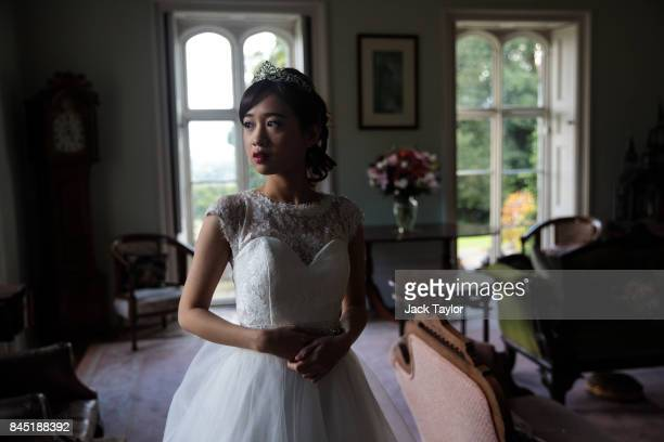 Debutante Annie Ding 20 from Hong Kong poses at Boughton Monchelsea Place ahead of the Queen Charlotte's Ball on September 9 2017 in Maidstone...