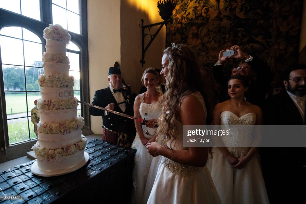 Debutante Eliza Lewis, 17 from Kent, who was named Debutante of the Year, cuts the cake with a sword at Leeds Castle during the Queen Charlotte's Ball on September 9, 2017 in Maidstone, England. In 1780 the first debutante's Ball was held by King George III to celebrate the birthday of his wife Queen Charlotte and raised money for a maternity hospital. Society girls were presented to the monarch and it became an annual event and important as a marriage market for the upper echelons of society. The London Season runs for six months of the year including sporting events, cocktail parties, dances and concerts and the Ball is the pinnacle of this season. After the present Queen terminated the practice of introducing debutantes at royal garden parties in 1957, Lady Howard de Walden followed by then editor of Tatler, Peter Townend, continued the tradition and on his death Peter nominated former debutantes Jennie Hallam-Peel and Patricia Woodall to take over running of The London Season. It is now focussed on raising money for children in need worldwide and the Queen Charlotte's Ball has been held in Shanghai and Dubai as well as various grand venues in London. This year the debutantes' gowns have been supplied by Berketex Brides and the cake, to which the debutantes curtsey, is made by Pretty Gorgeous Cakes.