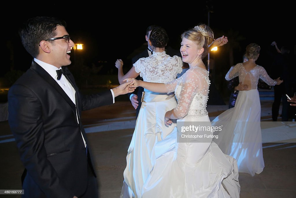Debutante Eloise Knight, aged 17, dances with her escort Raunak Bhojwani, 18, during The London Season on The World Ball on November 14, 2013 in Dubai, United Arab Emirates. Debutantes, royalty and aristocracy, attended The London Season Ball on the World hosted on the exclusive and privately owned Royal Island off the coast of Dubai. The ball follows the tradition of the historical Queen Charlotte's Ball held annually in London. The ball is the inaugural party of the London Season Academy in Dubai, offering classes in etiquette in social and business protocol.